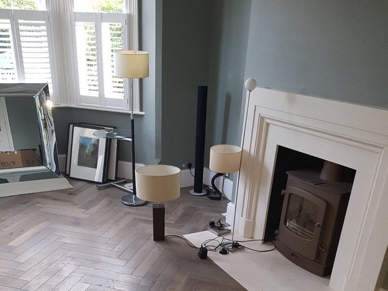 Living room refurbishment with a fireplace