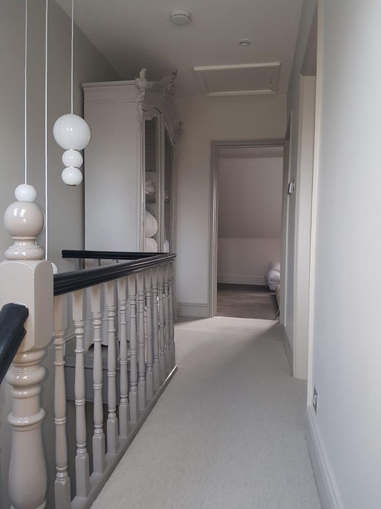Home refurbishment pastel grey hallway